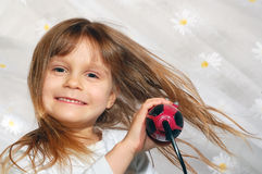 Girl blowing dry her hair Stock Photography