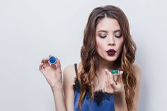 Girl blowing glitter, cosmetics, professional makeup. Beauty, skin care stock photos