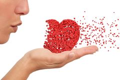 Girl blowing a heart. Girl blowin a heart made of little hearts holding on her hand desintegrating on a white isolated background Stock Photography