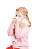 Girl is blowing her nose. Isolated on white Royalty Free Stock Images