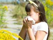 Girl is blowing her nose Royalty Free Stock Photos