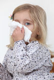 Girl blowing her nose Stock Images