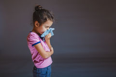 Girl blowing his nose into a handkerchief Royalty Free Stock Photography
