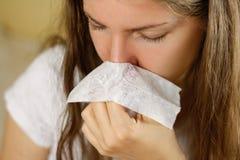 Girl blowing his nose into a white handkerchief. Runny nose. Clo Stock Photos