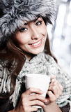 Girl blowing on hot drink Royalty Free Stock Photo