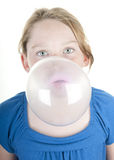 Girl blowing huge bubble Royalty Free Stock Photos
