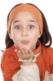 Girl blowing a kiss Stock Photography