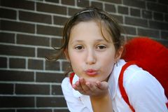 Girl blowing a kiss Stock Photos