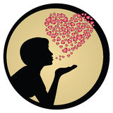 Girl blowing kiss silhouette. Lateral view of a girl silhouette blowing a kiss , with small hearts in a shape of a bigger heart in the background against a Royalty Free Stock Photo