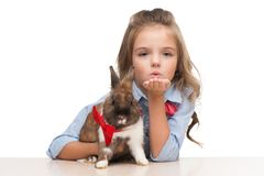Girl blowing a kiss to camera with bunny Stock Photography