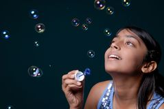Girl blowing lots of bubble Royalty Free Stock Photography