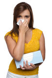 Girl Blowing Nose. Isolated sick girl blowing nose Royalty Free Stock Image