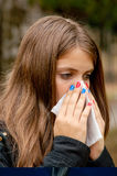 Girl blowing nose Stock Photography