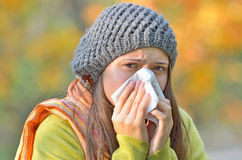 Girl blowing nose stock images