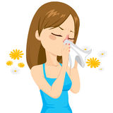 Girl Blowing Nose With Tissue Royalty Free Stock Photography