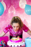 Girl blowing Out Candles Stock Photography