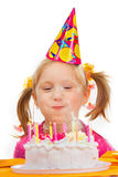 Girl blowing out candles Royalty Free Stock Images
