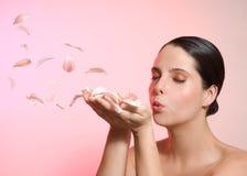Girl blowing petal Stock Image