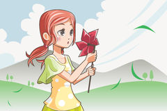 Girl blowing pinwheel Royalty Free Stock Image