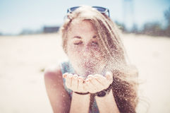 Girl blowing sand Royalty Free Stock Photography