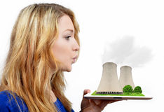 Girl blowing smoke from the nuclear power plant Stock Photo