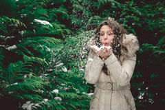 Girl blowing snow. In a forest Stock Photos