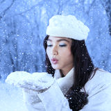Girl blowing snow outdoor Royalty Free Stock Photography