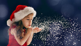 Girl blowing on snow. Winter time! Happy little girl blowing on snow Stock Photos