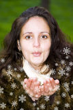 Girl blowing snowflakes Royalty Free Stock Photo
