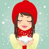 Girl Blowing Snowflakes Stock Photos