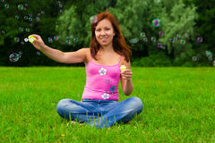 Girl blowing soap bubbles Royalty Free Stock Image