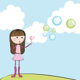 Girl blowing soap bubbles Royalty Free Stock Images
