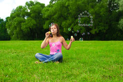 Girl blowing soap bubbles Stock Photography
