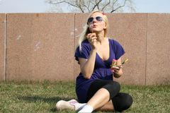 Girl blowing soap bubbles Stock Photo