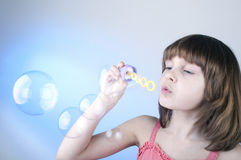 Girl blowing soap bubbles Royalty Free Stock Photography