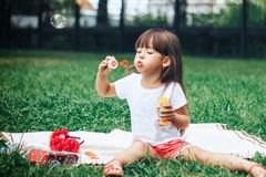 Girl blowing soap bubbles royalty free stock photos