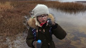 Girl blowing soap bubbles. In winter day stock video footage