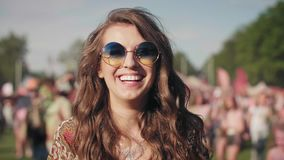 Girl blowing some confetti pieces. Portrait of happy girl blowing some confetti pieces in festival stock footage