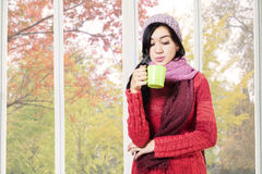 Girl blowing warm drink Stock Photo