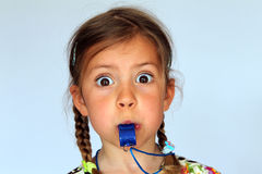 Girl blowing whistle Stock Image