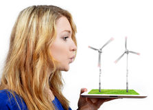 Girl blowing on the wind turbines Stock Image