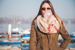 Girl blows big bubble from bubble gum Stock Images