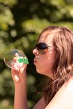 Girl blows a bubble Stock Photography
