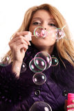 Girl blows bubbles Royalty Free Stock Image