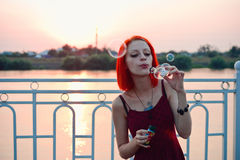 Girl Blows Bubbles Stock Image