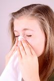 Girl blows her nose with handkerchief, health concept Stock Photos