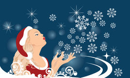The girl blows off snowflakes from the hand. Vector illustration in AI-EPS8 format Stock Image