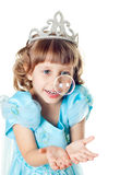 The girl blows a soap bubble Royalty Free Stock Photo