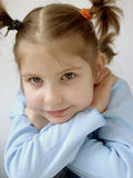 Girl in blue 10. Small pretty girl in a blue jersey Stock Images