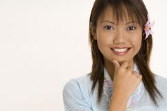 Girl In Blue 4. A pretty young asian woman in a light blue top Royalty Free Stock Image